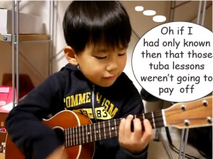 talented boy playing the ukulele (from youtube)