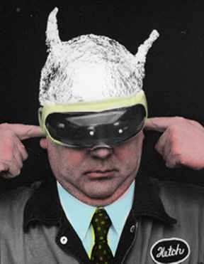 A man wearing a tin foil hat with his hands in his ears